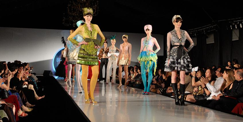 Models walking down the catwalk at a fashion show.
